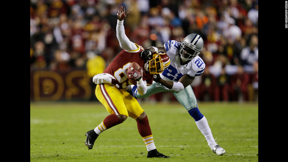 Santana Moss of the Washington Redskins is tackled by Mike Jenkins of the Dallas Cowboys after catching a pass on Sunday.