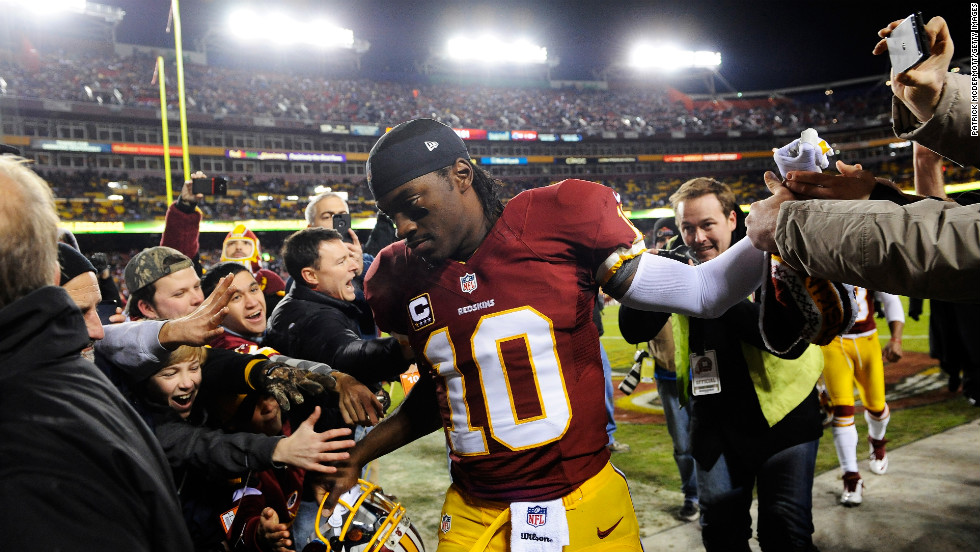 Redskins quarterback Robert Griffin III greets fans prior to Sunday's game against the Dallas Cowboys at FedExField.