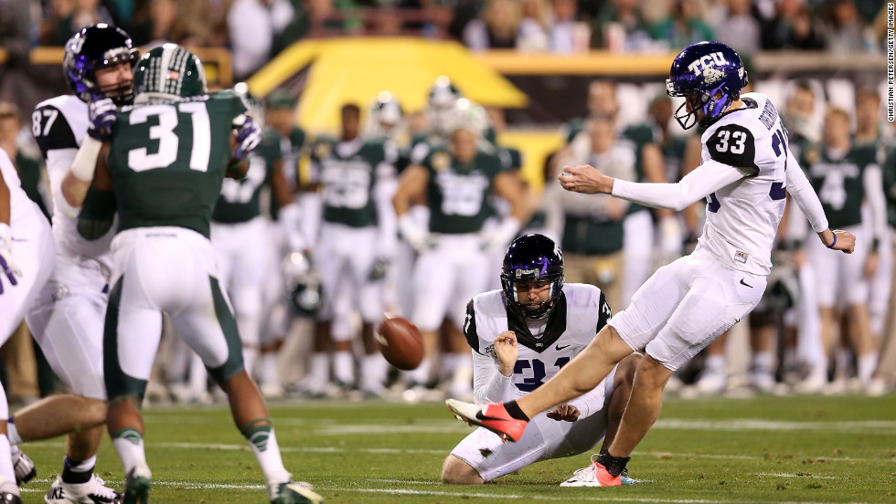 Jaden Oberkrom of the TCU Horned Frogs kicks a second-quarter field goal against the Michigan State Spartans during the Buffalo Wild Wings Bowl at Sun Devil Stadium on December 29 in Tempe, Arizona.