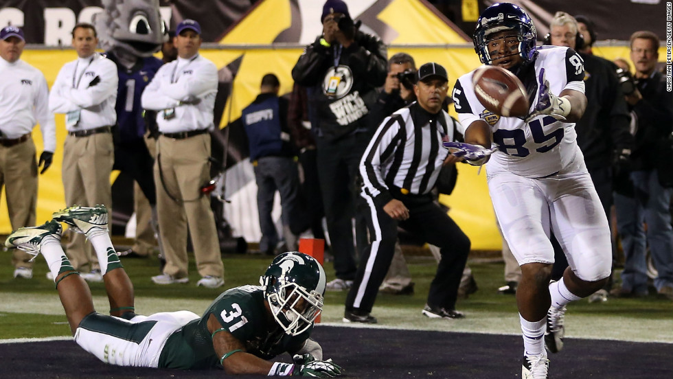 LaDarius Brown of the Horned Frogs is unable to catch a pass in the end zone past Darqueze Dennard of the Michigan State Spartans during the second quarter on December 29.