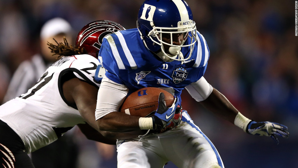 Cincinnati's Camerron Cheatham tries to stop Duke's Jamison Crowder on December 27.