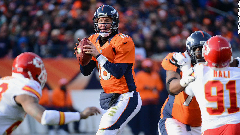 Peyton Manning of the Denver Broncos looks to throw a pass during the game against the Kansas City Chiefs on Sunday at Mile High Stadium in Denver.