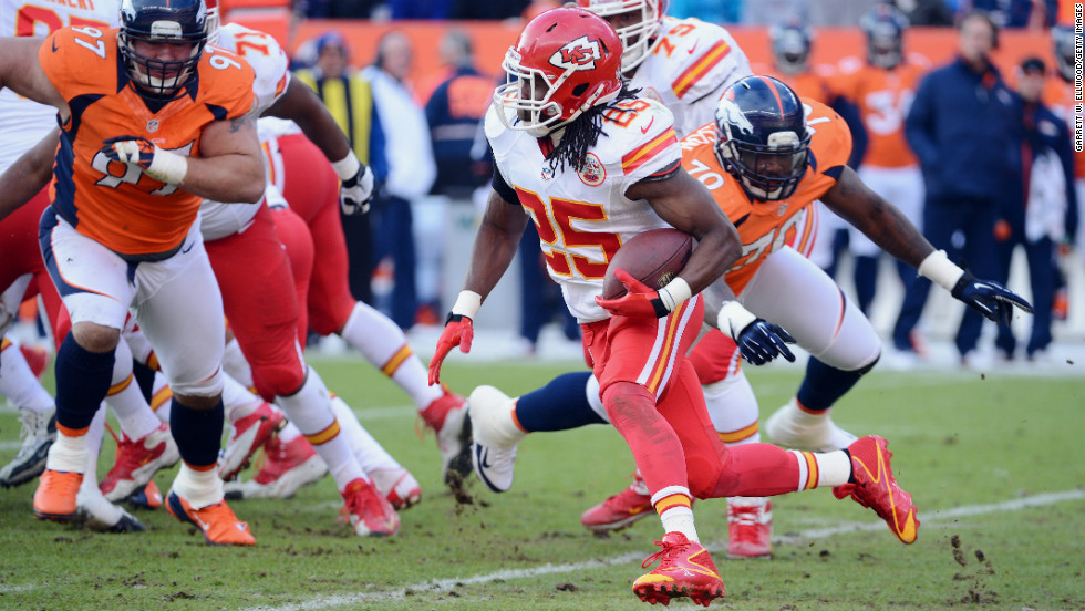 Jamaal Charles of the Kansas City Chiefs runs the ball against Justin Bannan, left, and Malik Jackson, right, of the Denver Broncos on Sunday.