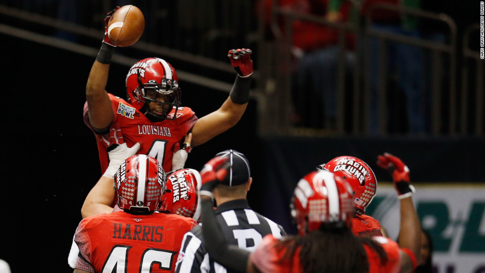 Louisiana-Lafayette's Javone Lawson celebrates after scoring a touchdown against East Carolina on December 22.
