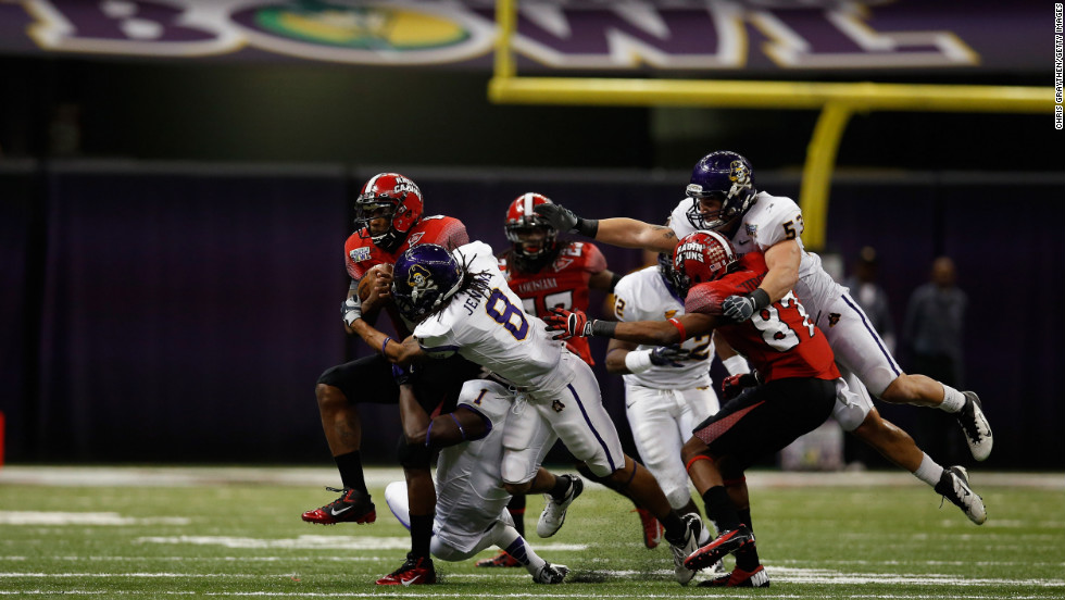Terrance Broadway of the Louisiana-Lafayette Ragin Cajuns is tackled by Jacobi Jenkins of East Carolina on December 22.