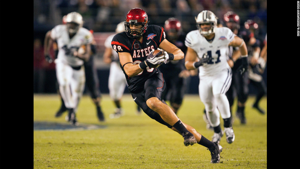 Gavin Escobar of the San Diego State Aztecs runs with the ball in the first half of the game against the BYU Cougars in the Poinsettia Bowl at Qualcomm Stadium on Thursday, December 20, in San Diego.
