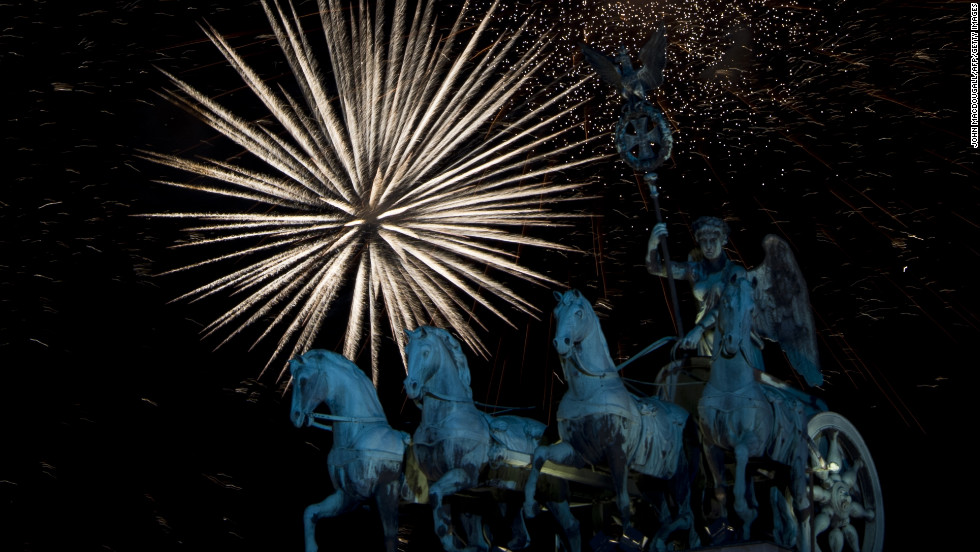 Fireworks erupt over the Brandenburg Gate on New Year's Eve in Berlin.
