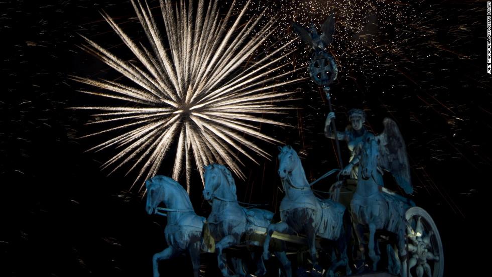 Fireworks erupt over the Brandenburg Gate on New Year's Eve in Berlin.