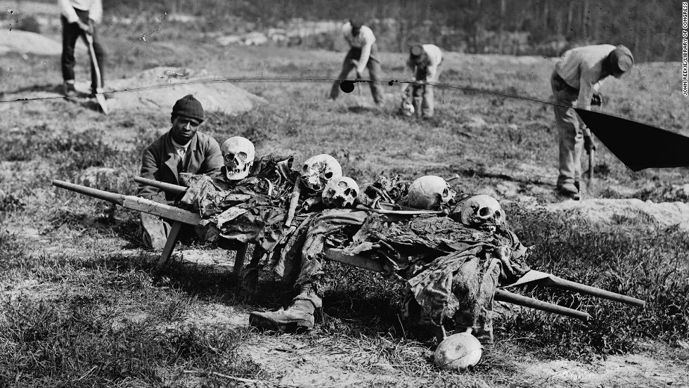 The bones of soldiers killed in battle are collected in Cold Harbor, Virginia, in 1865.