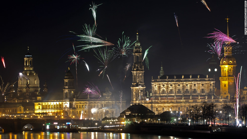 Fireworks erupt over on the Elbe River during New Year's Eve celebrations in Dresden.