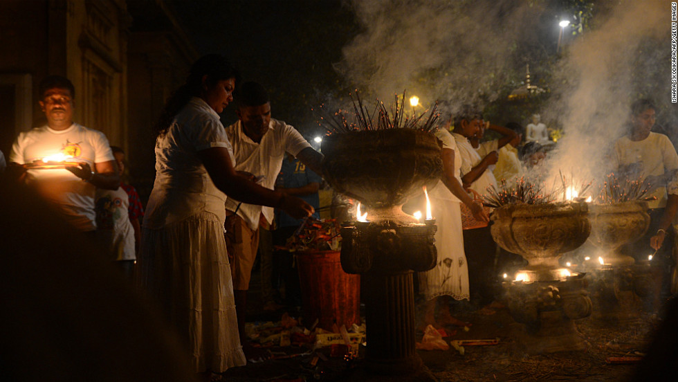 Sri Lankan Buddhists light incense sticks as they offer prayers at the Kelaniya Temple in Kelaniya. Many marked the beginning of 2013 with religious ceremonies.