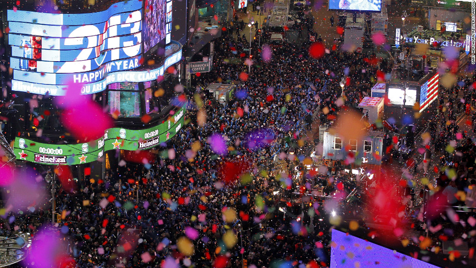 Confetti is dropped on revelers at midnight during New Year celebrations in Times Square in New York on Tuesday, January 1.
