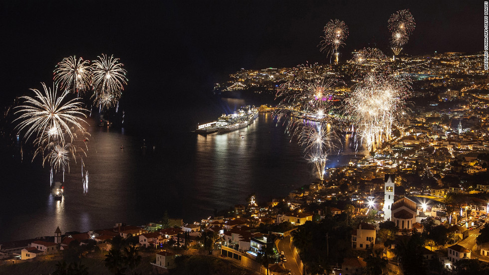 Fireworks light up the sky above Funchal Bay, Madeira Island, to celebrate the arrival of the new year in Portugual.
