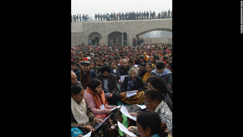Delhi Chief Minister Sheila Dikshit, center, participates in a group prayer during the Women's Dignity March on January 2.