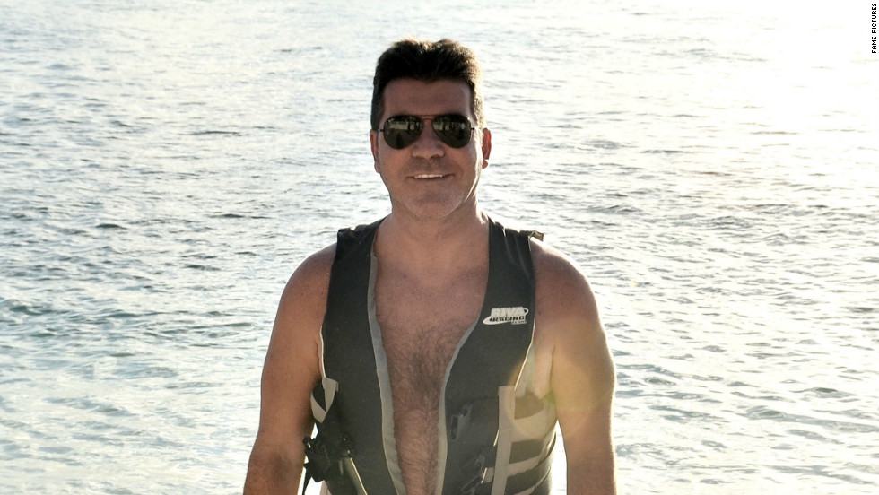 Simon Cowell enjoys the beach in Barbados on December 31.