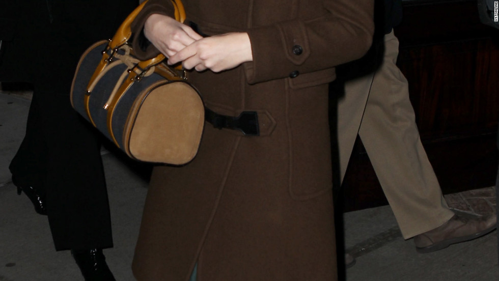 Taylor Swift keeps warm as she heads out on December 31.