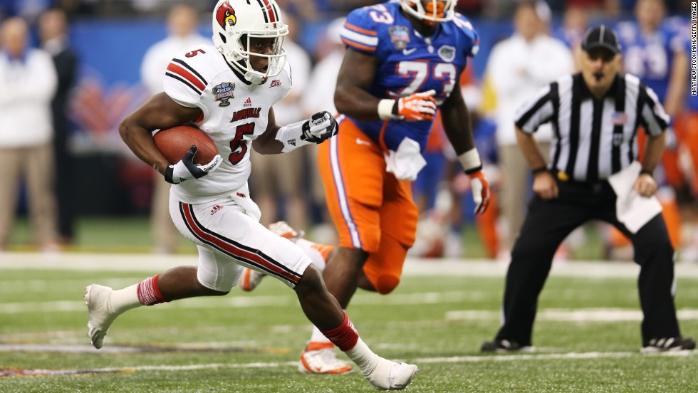 Quarterback Teddy Bridgewater of the Louisville Cardinals runs the ball in the first quarter against the Florida Gators during the Allstate Sugar Bowl at Mercedes-Benz Superdome on Wednesday, January 2, in New Orleans.
