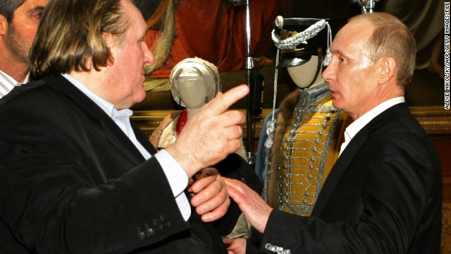 (File) Photo taken on December 11, 2010, shows Vladimir Putin (R) speaking with French actor Gerard Depardieu in St. Petersburg.