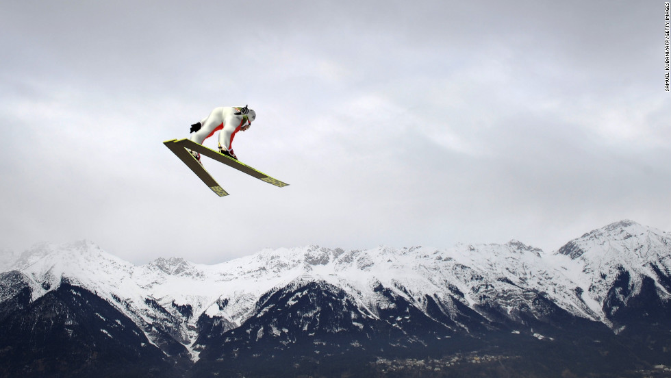 Simon Ammann of Switzerland becomes part of an Alpine view during a training jump on January 3.