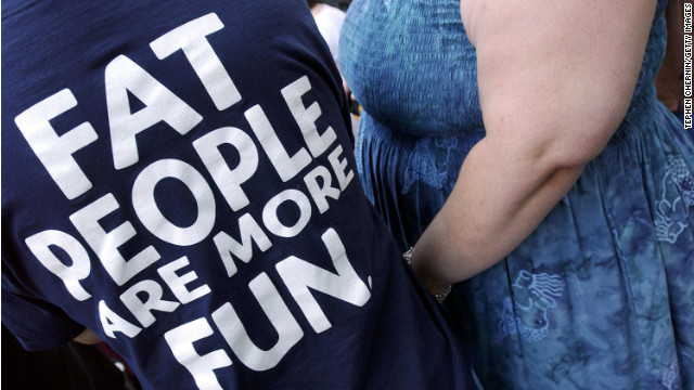 An activist at a National Association to Advance Fat Acceptance rally in New York wears a T-shirt to promote self-image.