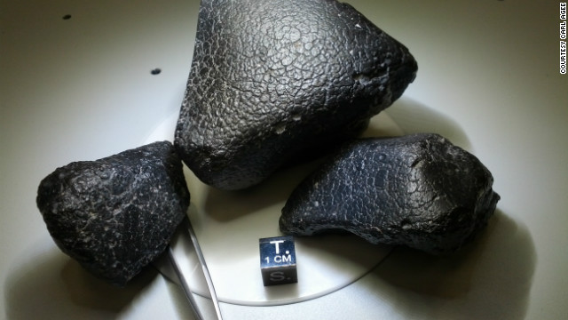 These three pieces are from the same meteorite. Scientists say they are rare specimens from the crust of Mars.