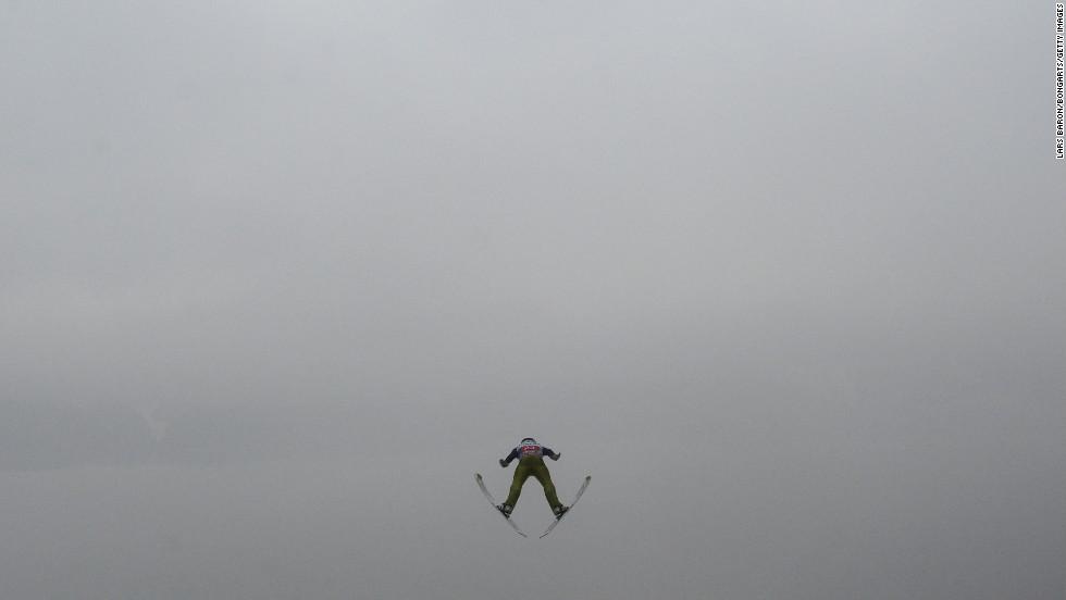 Jaka Hvala of Slovenia flies through the air on January 4.