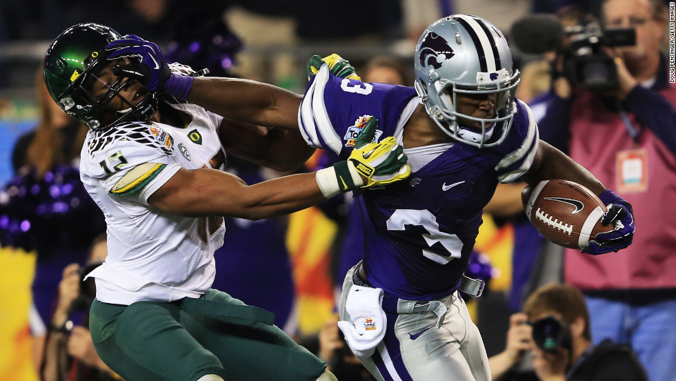 Brian Jackson of the Oregon Ducks tries to tackle Chris Harper of the Kansas State Wildcats during the Tostitos Fiesta Bowl on January 3.
