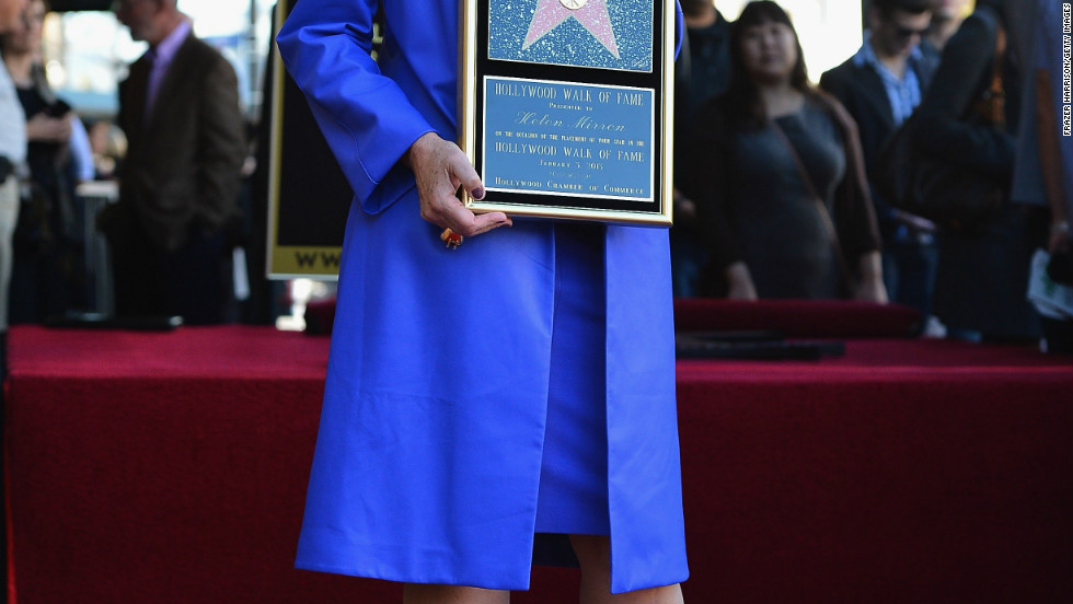 Helen Mirren holds up her award during her January 3 ceremony to celebrate her star on the Hollywood Walk of Fame.
