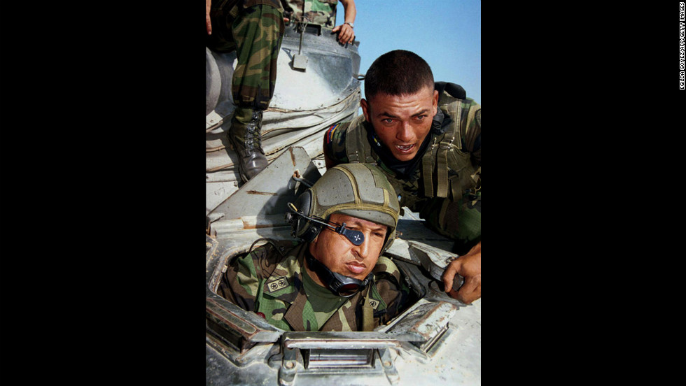 Chavez inspects military maneuvers of the national Air Force on March 17, 2001, in Catilletes near the border with Colombia. In June 2000, Chavez was re-elected to the presidency for a six-year term, under the new constitution created by his government in 1999.