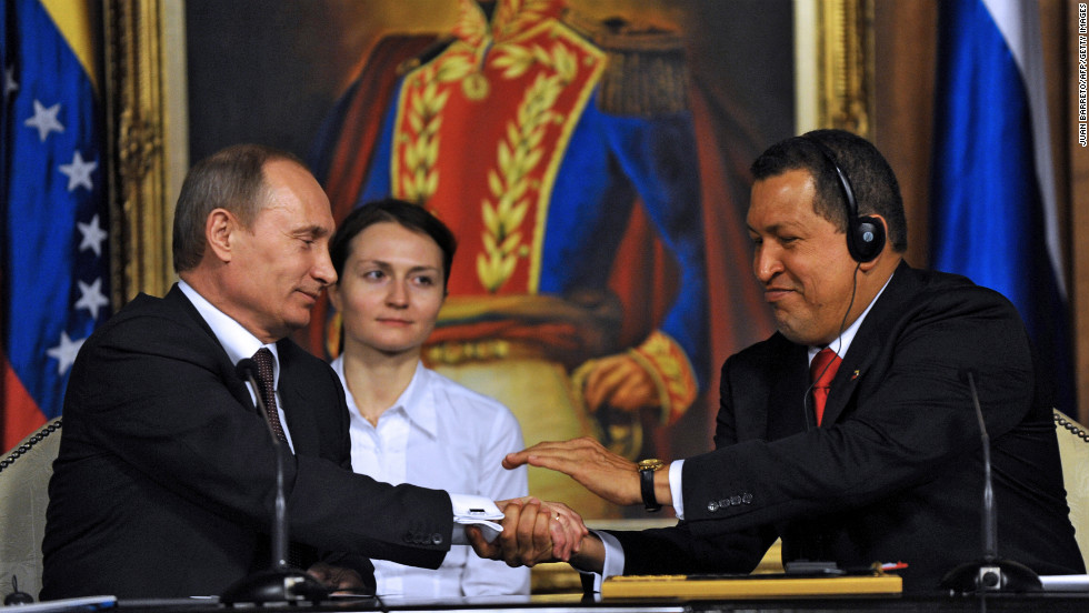 Chavez, right, greets Russian Prime Minister Vladimir Putin during his visit to the presidential palace in Caracas on April 2, 2010.