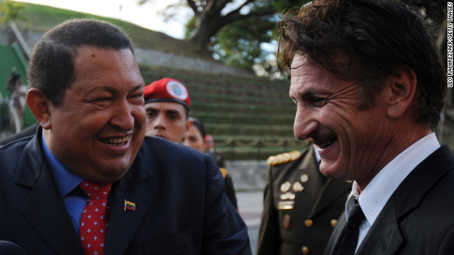 The late President Hugo Chavez laughs as he talks with actor Sean Penn during a 2012 visit.
