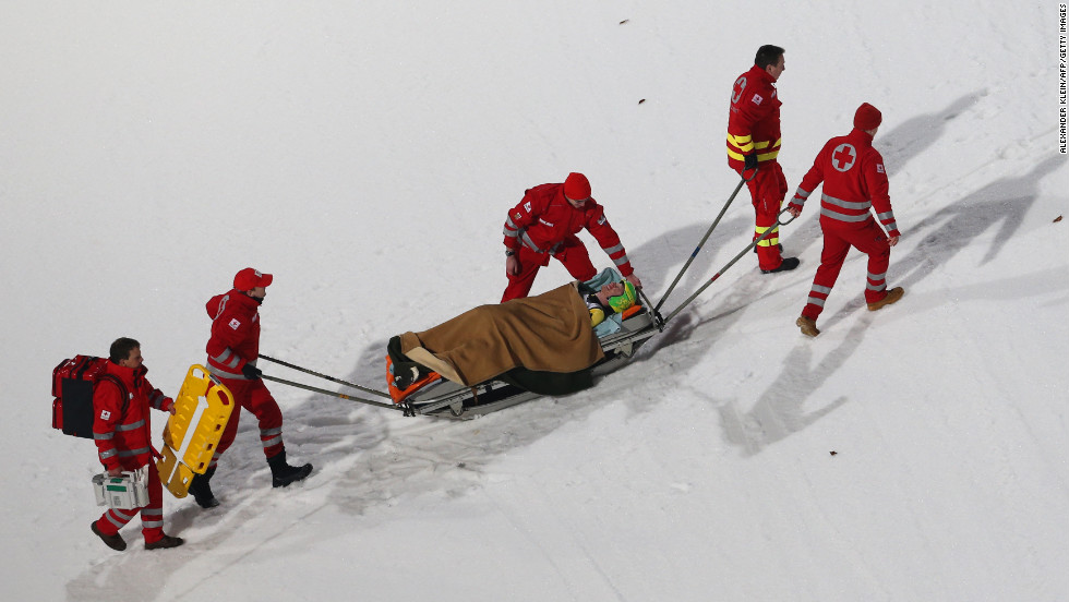 Medical staffers carry Russia's Denis Kornilov during a practice session on January 5.
