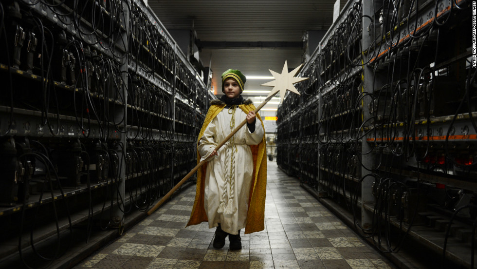 "A young carol singer visits the coal mine Prosper Haniel Schacht 10 on Friday, January 4, in Bottrop, western Germany. The 2013 ""Three Kings Action"" charity focuses on the plight of children in Tanzania."