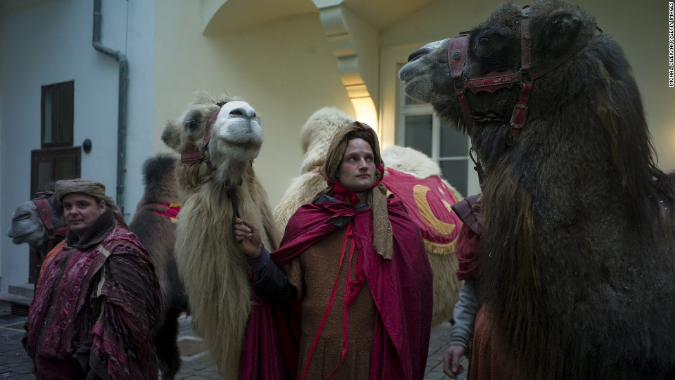A man holds a camel before a traditional march from Prague Castle to a nativity scene representing Bethlehem's manger on Saturday, January 5, in Prague, Czech Republic. The annual Three Kings Procession in Prague re-enacts the journey of the Three Magi to the infant Jesus.