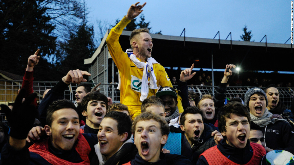 Epinal supporters celebrated with their players following the shock penalty shootout victory over cup holder Lyon following a pulsating 3-3 draw. Lyon is second in Ligue 1, level on points with Paris Saint-Germain at the top.