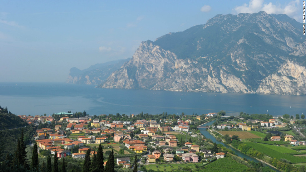 The picturesque town of Nago Torbole basks in the summer sunshine on the banks of Lake Garda.
