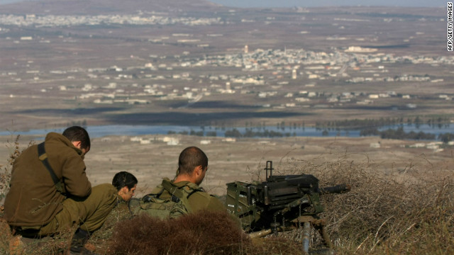 (File photo) Israeli soldiers stands in an abandoned military outpost overlooking the ceasefire line between Israel and Syria on Tal Hazika near Alonei Habshan in the Israeli-occupied Golan Heights on November 15, 2012.