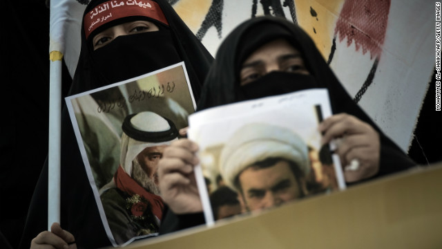 Bahraini women hold portraits of relatives being held in Bahraini jails in Sanabis, west of Manama, on January 6, 2013.