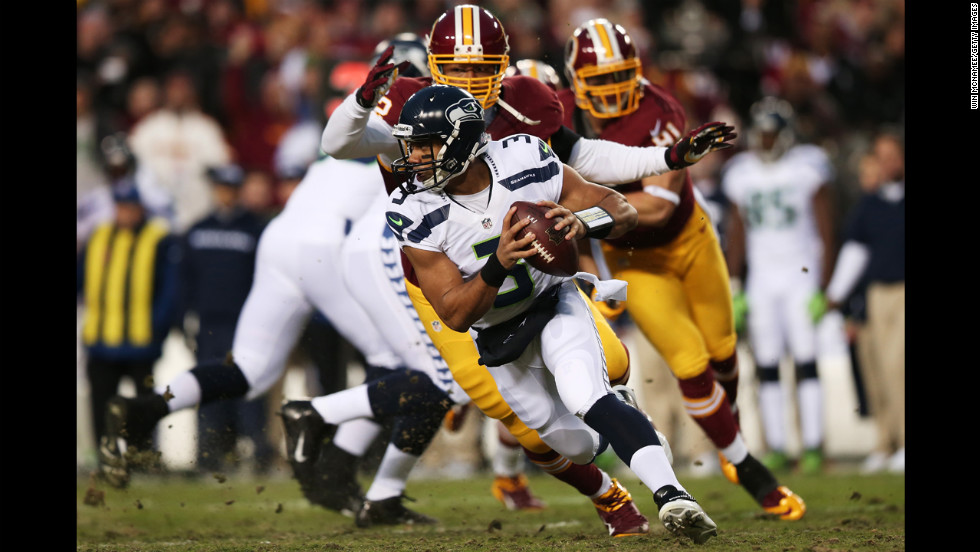 Russell Wilson of the Seattle Seahawks is sacked by Stephen Bowen of the Washington Redskins on Sunday.