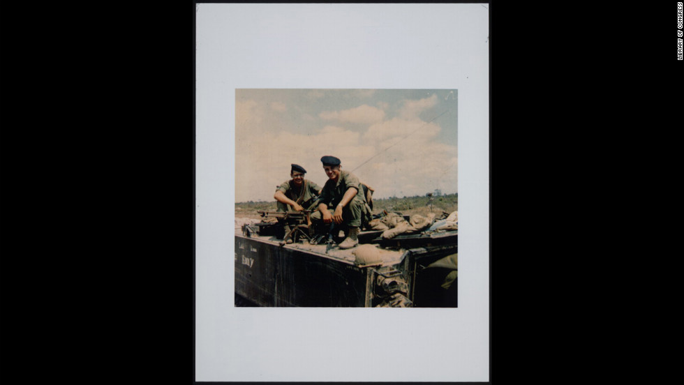 Hagel, right, perched on top of a M113 armored personnel carrier in 1968.