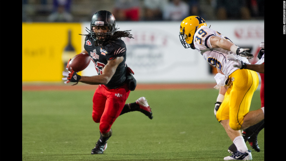 Arkansas State wide receiver J.D. McKissic eyes a run past Kent State safety Luke Wollet on Sunday, January 6,  at Ladd-Peebles Stadium in Mobile, Alabama. Arkansas State defeated Kent State 17-13 in the GoDaddy.com Bowl.