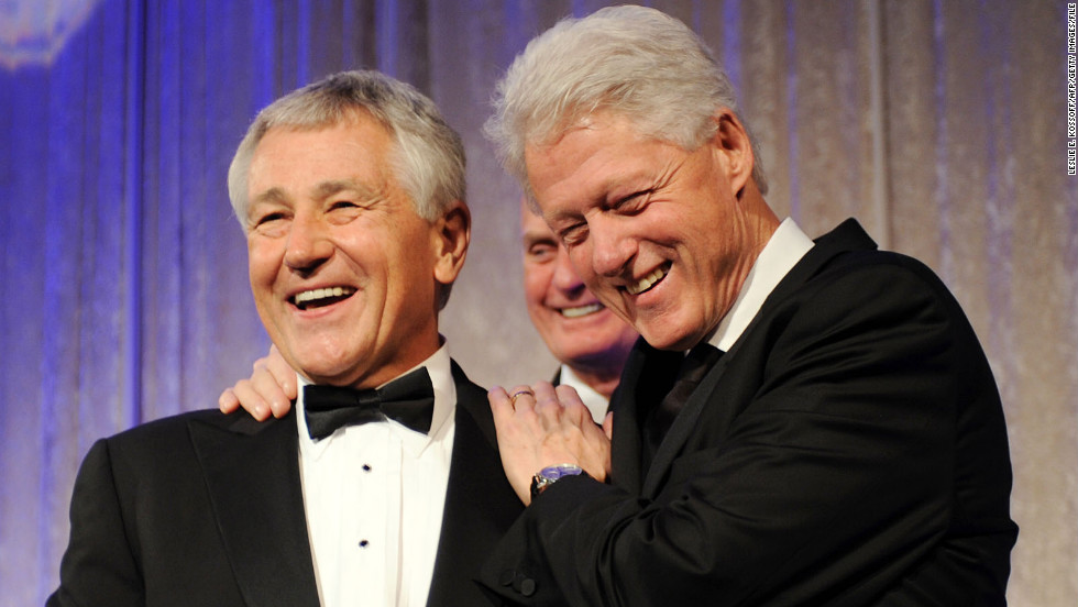 Hagel presents former President Bill Clinton with the Atlantic Council's Distinguished International Leadership Award in Washington in April 2010.