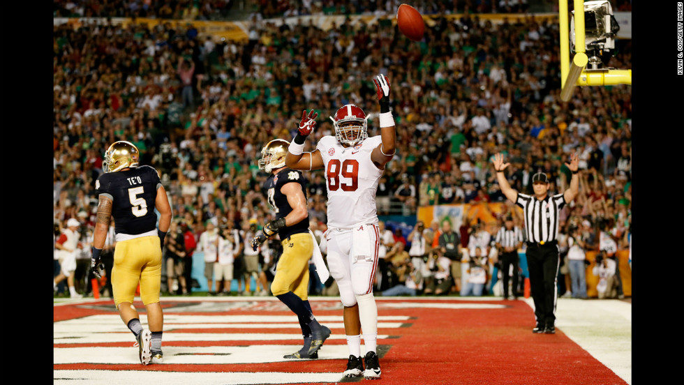 Michael Williams of the Alabama Crimson Tide celebrates his first-quarter touchdown against the Notre Dame Fighting Irish.