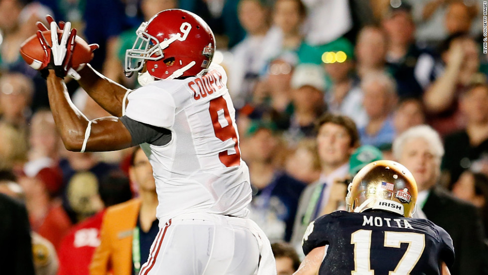Amari Cooper of Alabama hauls in a pass in front of Zeke Motta of Notre Dame.