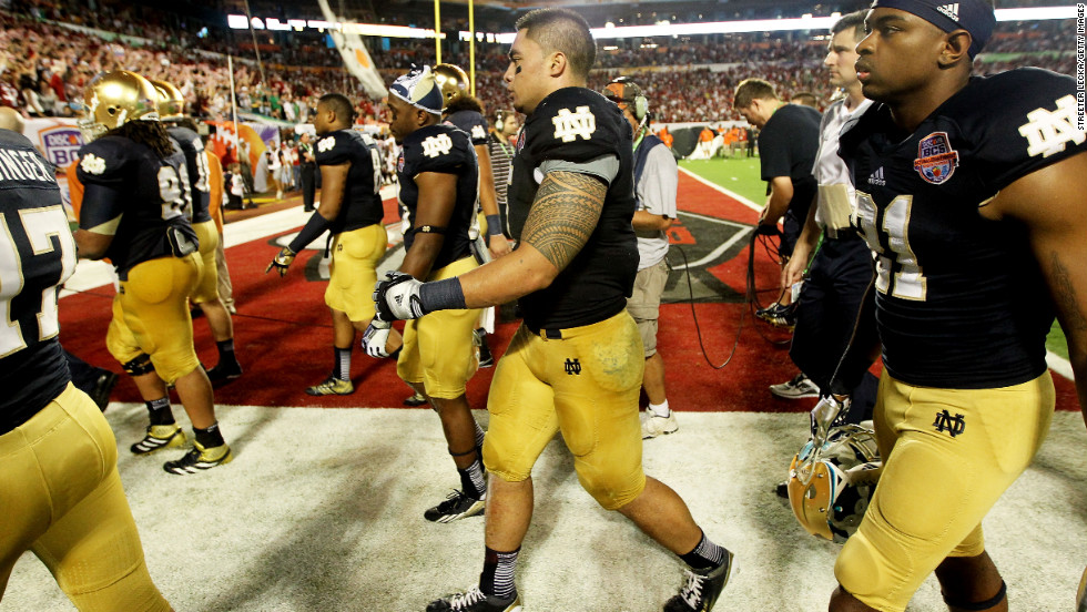 Notre Dame's Manti Te'o, center, and his teammates walk off the field at halftime. Alabama led 28-0 at the half.