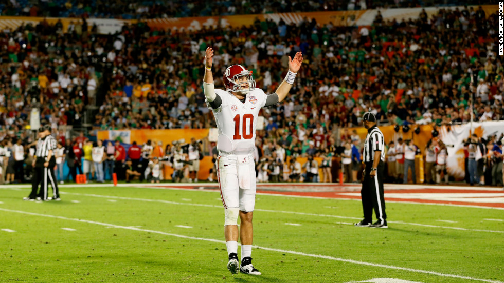 Alabama's AJ McCarron acknowledges the crowd during the game on Monday.