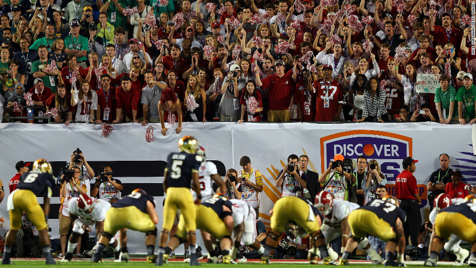 Alabama fans cheer as Notre Dame's offense lines up late in the game on Monday.