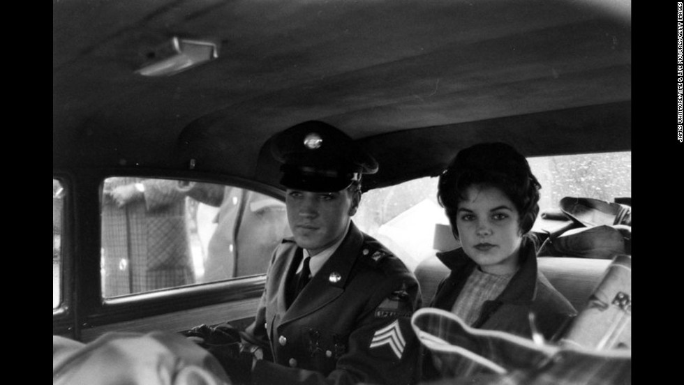 Elvis and Priscilla Beaulieu leave the house he and his family occupied in Bad Nauheim, Germany in March 1960.