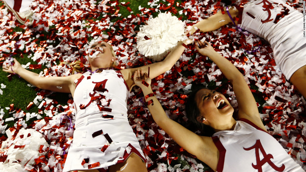 Crimson Tide cheerleaders celebrate on the field after the game.