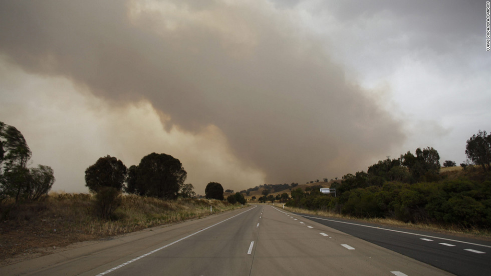 Smoke is seen billowing over the closed Hume Highway near Tarcutta in New South Wales on Tuesday.